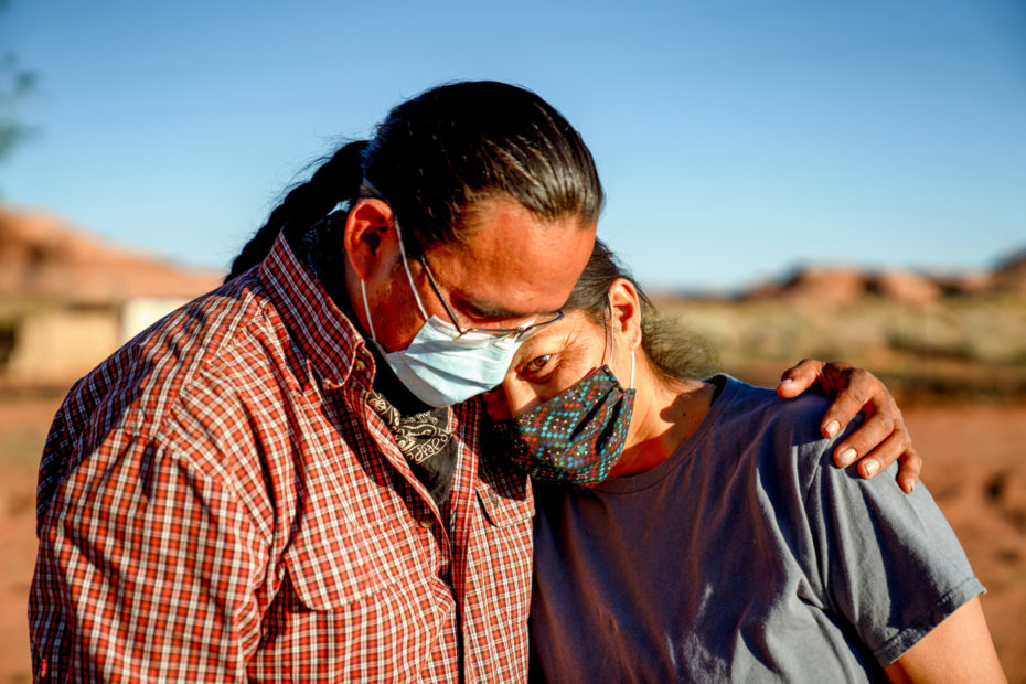 A Native man is comforting a Native woman.